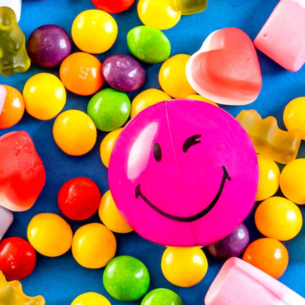Purple Smiley Halves on a pile of sweets