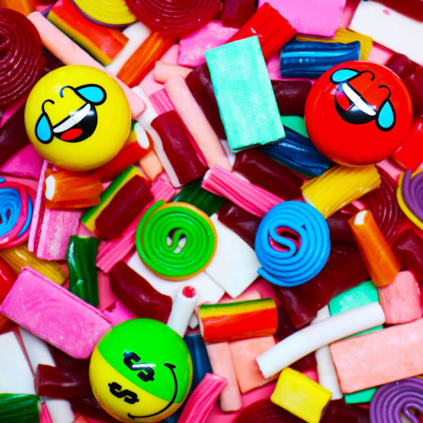 Smiley Halves on a large pile of sweets